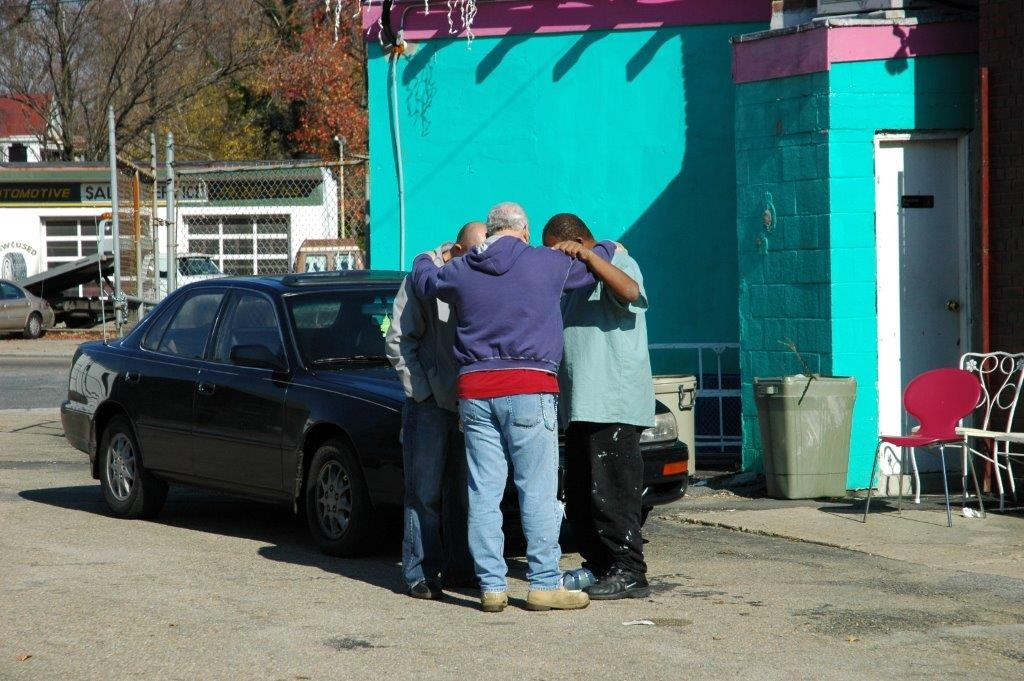 Praying in parking lot