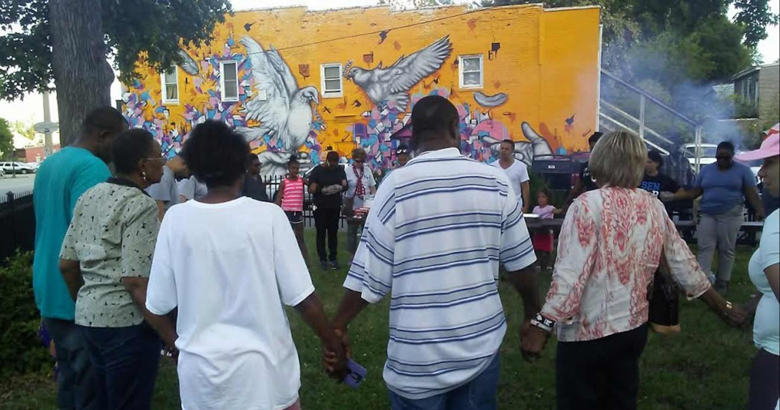 The people uniting in prayer in Highland Park